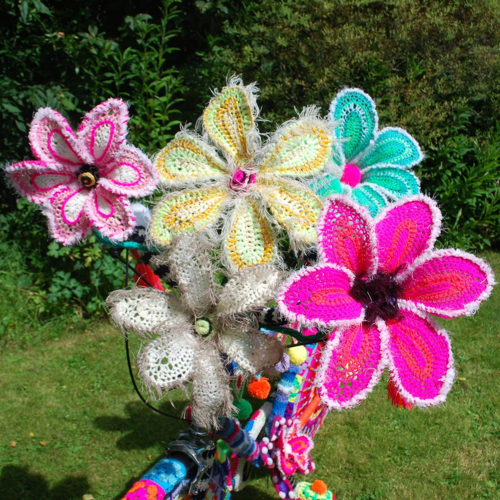 Giant crochet flowers on yarn bomb bike by Emma Leith