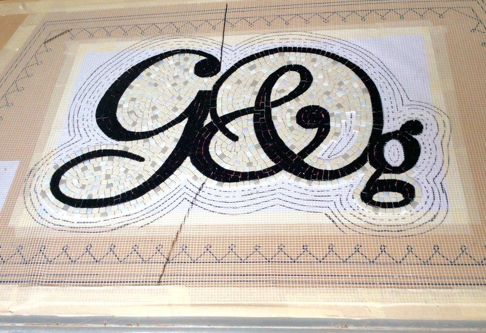 Making a mosaic on mesh.  Graham and Green shop doorway mosaic.