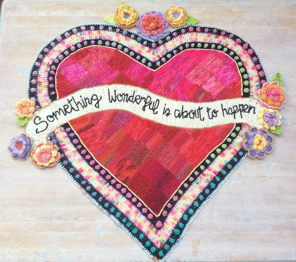 'Something wonderful is about to happen' crochet heart wall art by crochet artist Emma Leith