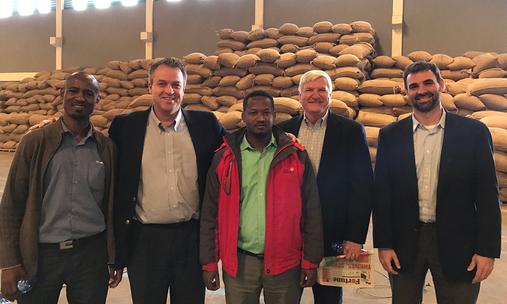 Jeff Risk (2nd from left), Joe Harding (2nd from right), and Nate Duncan (far right) meeting with our coffee partners in Ethiopia.