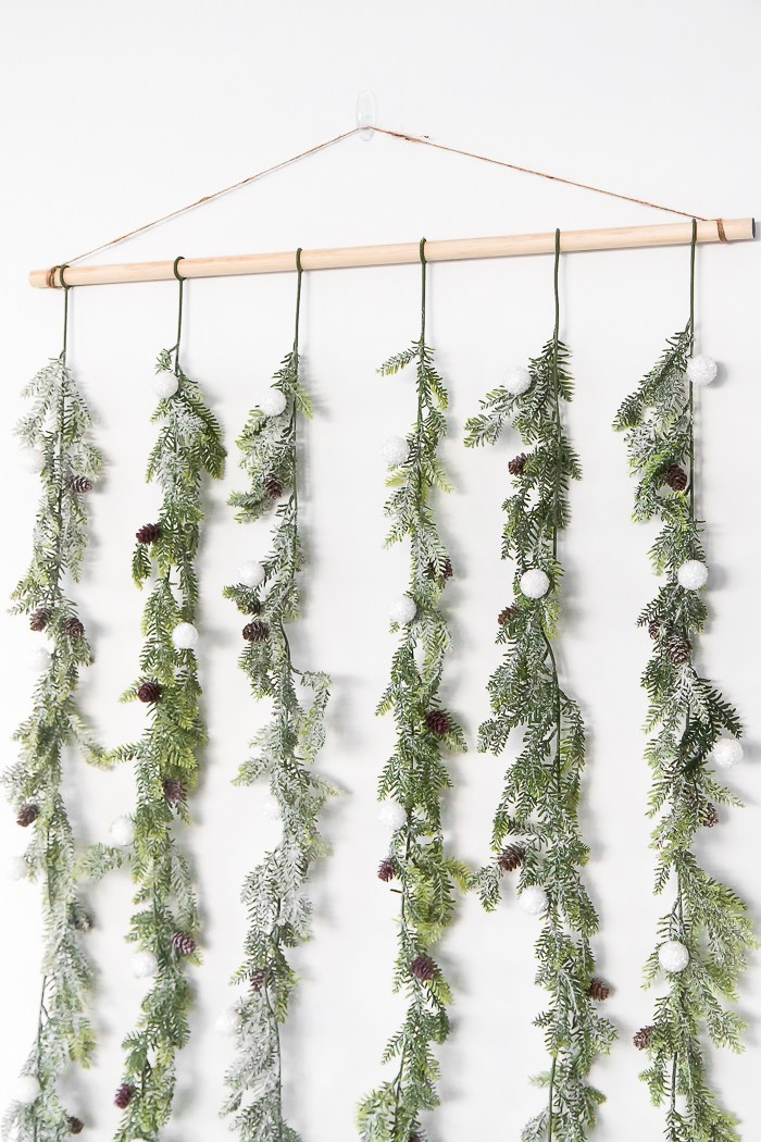 indoor garlands - a little something different...Garlands no longer belong outside on your front porch and they also no longer have to be one long strand of greenery. This new take on a garland is fun and modern and can really go anywhere in your home. It definitely still has that Christmas-y charm that we love!