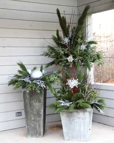 outdoor urns  - the bushier the better...Urns are an easy way to get into festive décor spirit. They also last pretty much all winter long! They look great when they are full of lots of greenery and tall bare branches. You can really beef up any urn by adding lots of evergreen, fraser fir, scotch and white pine branches.To create a more Christmas-y urn, add in seasonal embellishments like pinecones, lights and even ornaments give it that holiday feel!