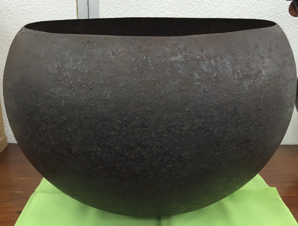 A very lightweight iron begging bowl about 11 inches wide and 8 high. Perhaps Muromachi? No proof or old signed box. Pure formal and tactile appeal.   Also, a few kimono.