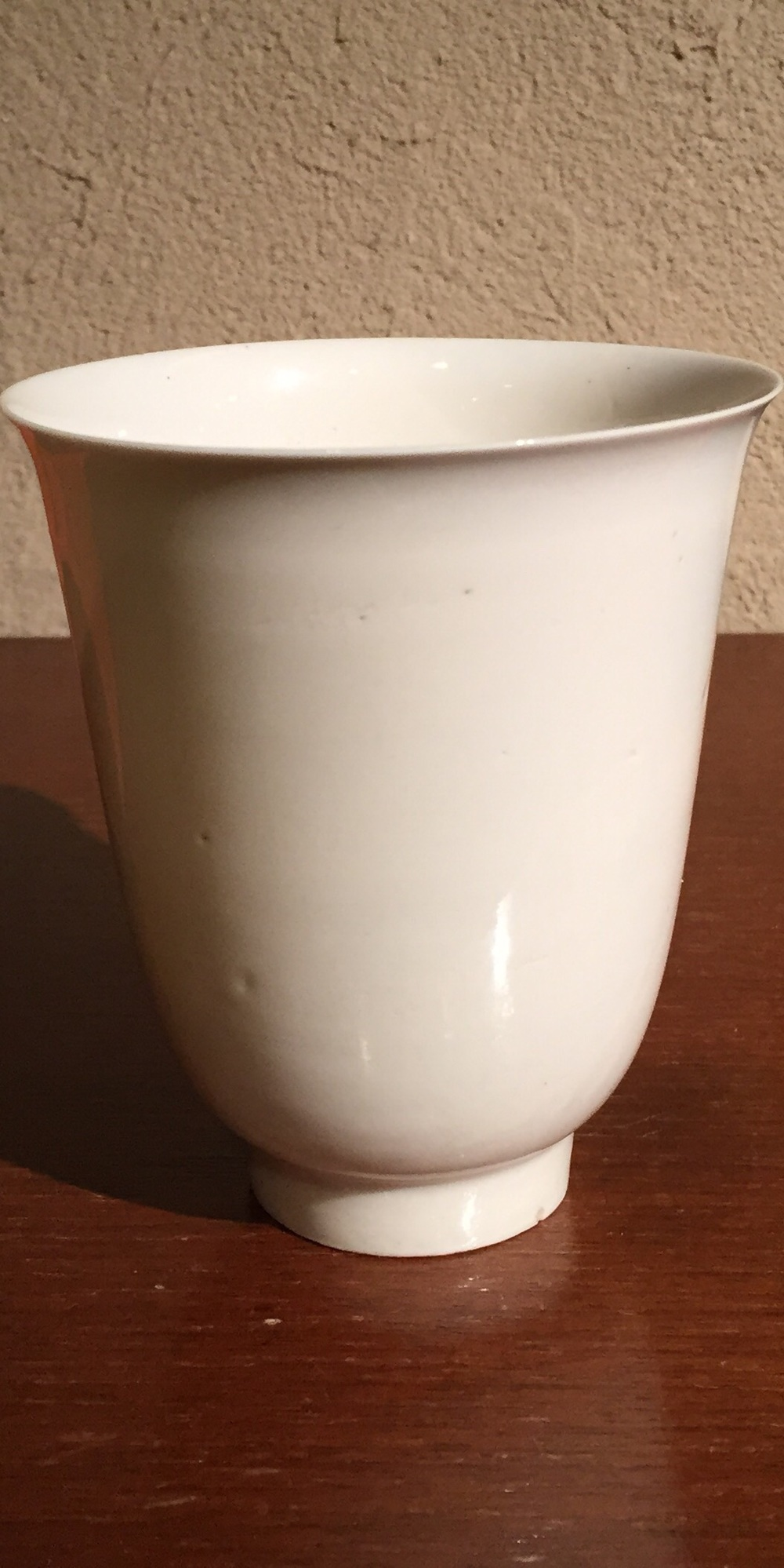 White pocelain cup.