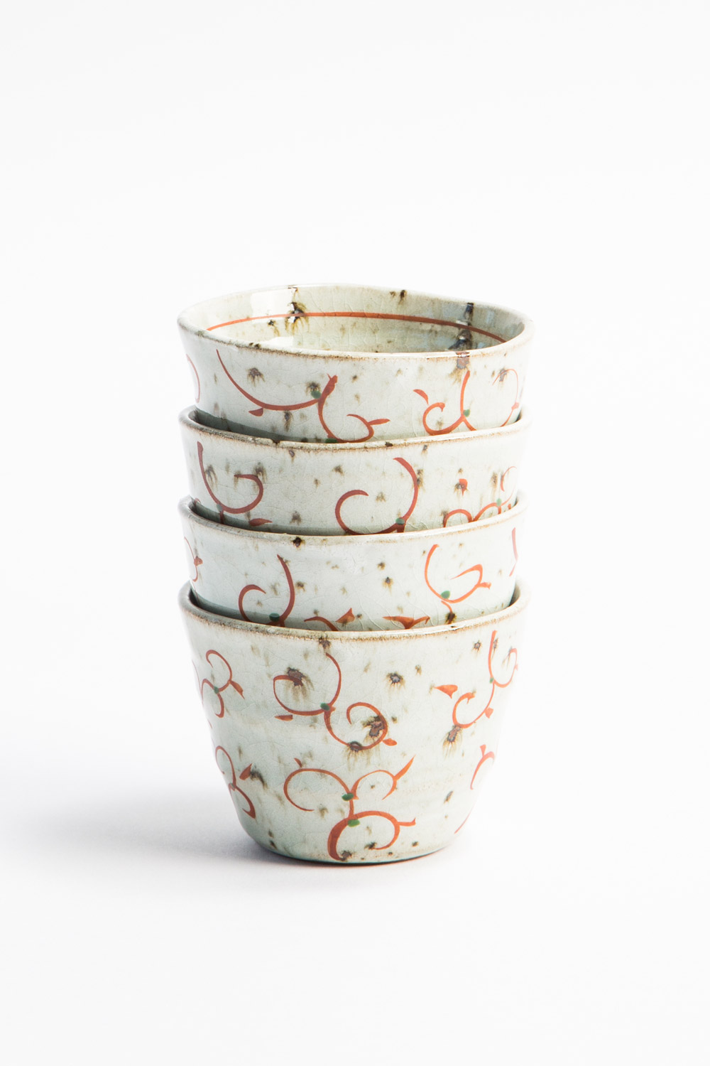 These Hand Glazed Japanese Stoneware Tea Cups have a red hand-painted motif for a touch of decorative whimsy. $22 each