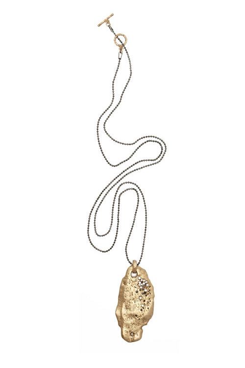 With a beautiful organic sea shell form, this bronze pendant randomly dotted with delicate CZs by Julie Cohn is a chic gift. $395