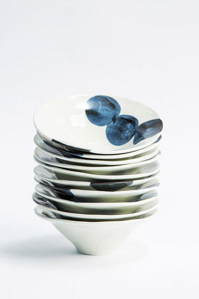 Japanese Porcelain Bowls   have a fun, modern look with hand painted indigo dots. $25 each