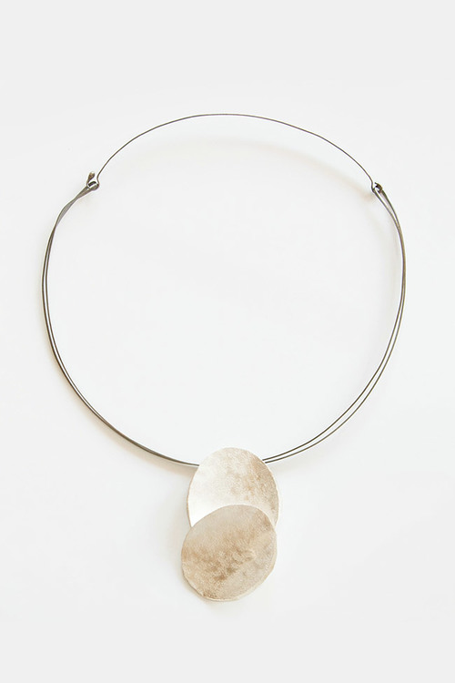 A   one-of-a-kind Necklace by artisan Reiko Ishayama   to gift your mother. Reiko handcrafted this oxidized silver double disc necklace on molded silver double wire for a delicately modern effect. $595