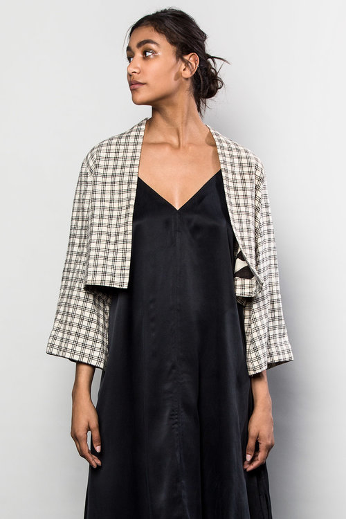 An Asiatica favorite is this one-of-a-kind Temple Jacket in Japanese White and Black Cotton Grid, lined with a graphic black and white printed Indian cotton. $1,595