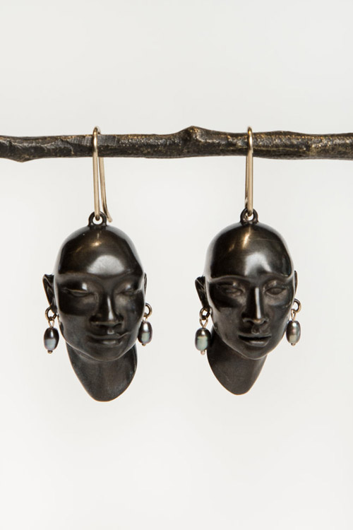 Gabriella Kiss Bronze Heads Earrings Wearing Black Pearl Earrings  $795