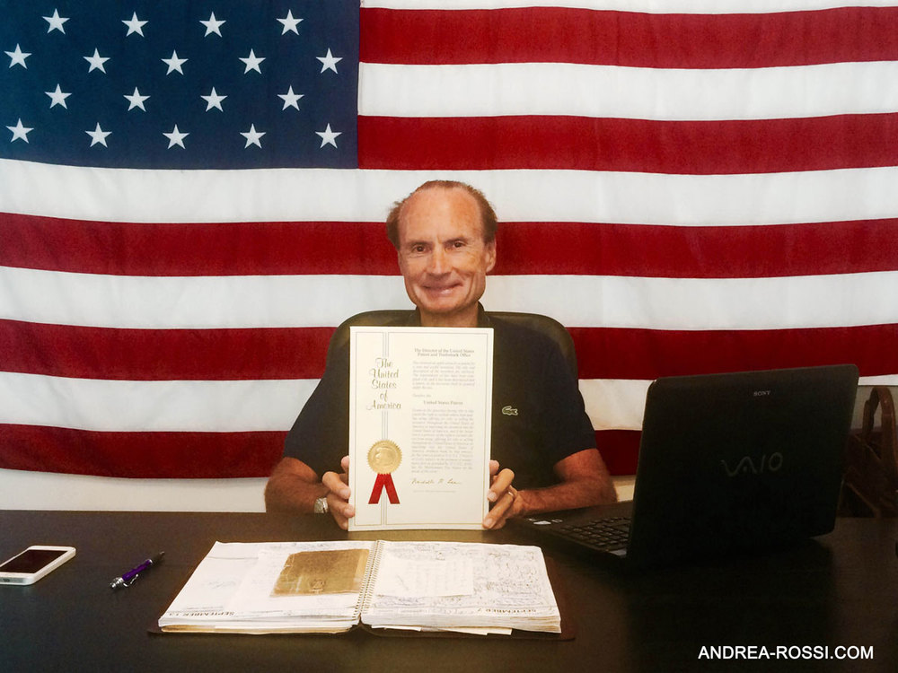 Andrea Rossi in the office of Leonardo Corp in Miami (Florida) when he receives the original ribbon- covered copy of his US Patent from the USPTO. The flag on the wall has been flown over the capitol Hill in Washington, DC.