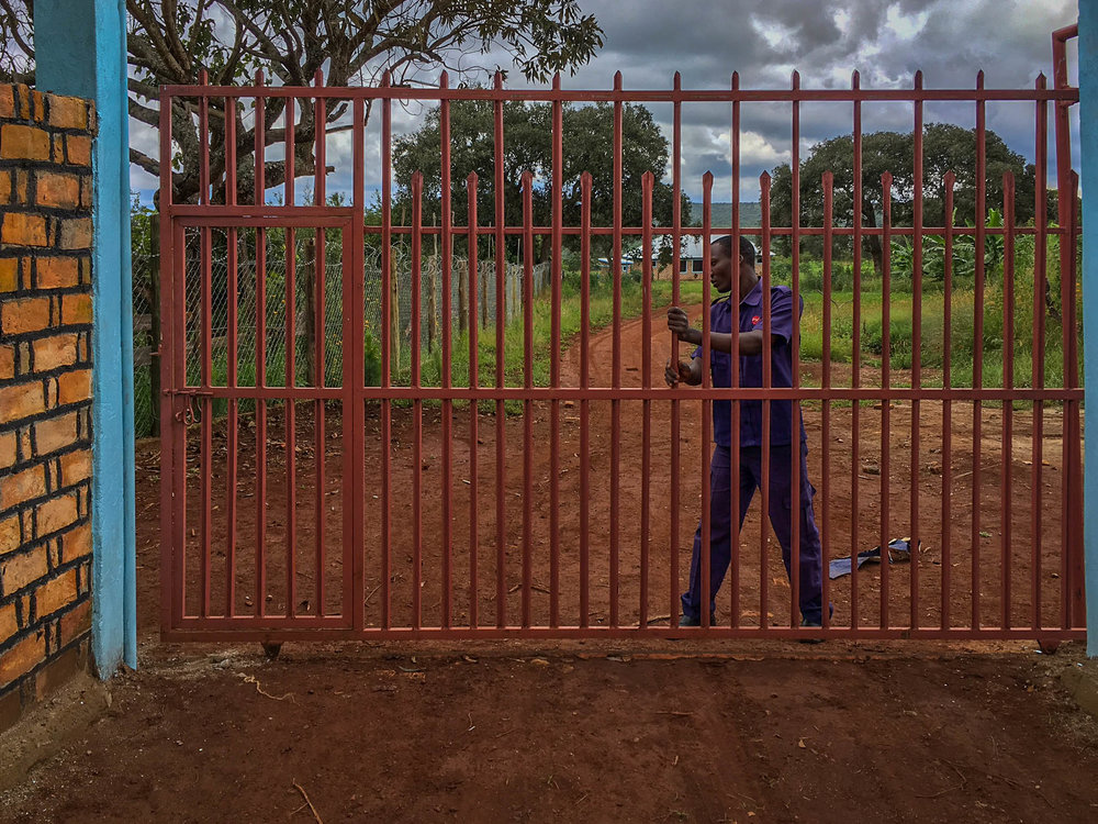 Security guard locking gate.jpg