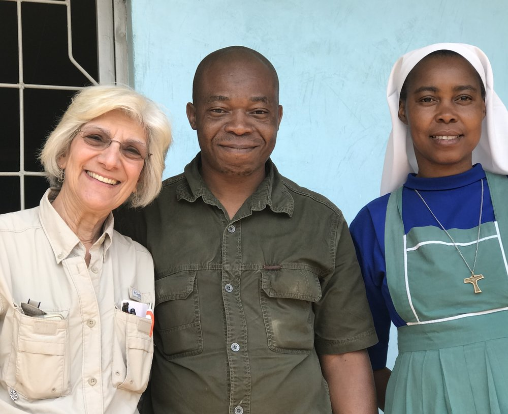 Mr. Ramadan Mugenyi (center) with Johanna Burani (left) and Sr. Dativa (right)