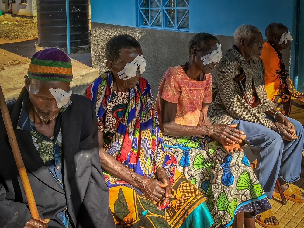 Some of the elderly with bandages after eye surgery, while others are still awaiting their turn.