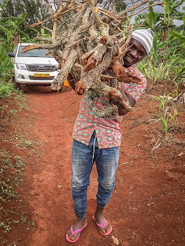 One of our youths hauling firewood from the truck to the elders