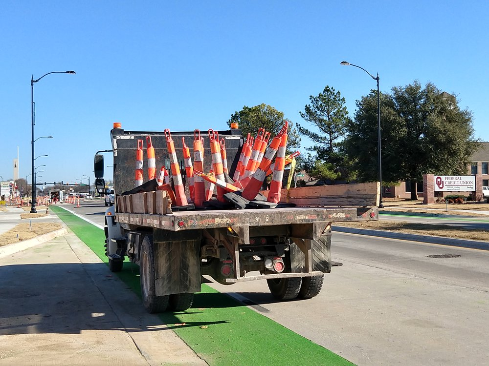 Farewell to the orange cones!!   Construction cones & traffic control devices were removed from Lindsey Street on the afternoon of Friday, December 15th, 2017.  Also, shown in this picture is the new bike lane and bus pullout lane.