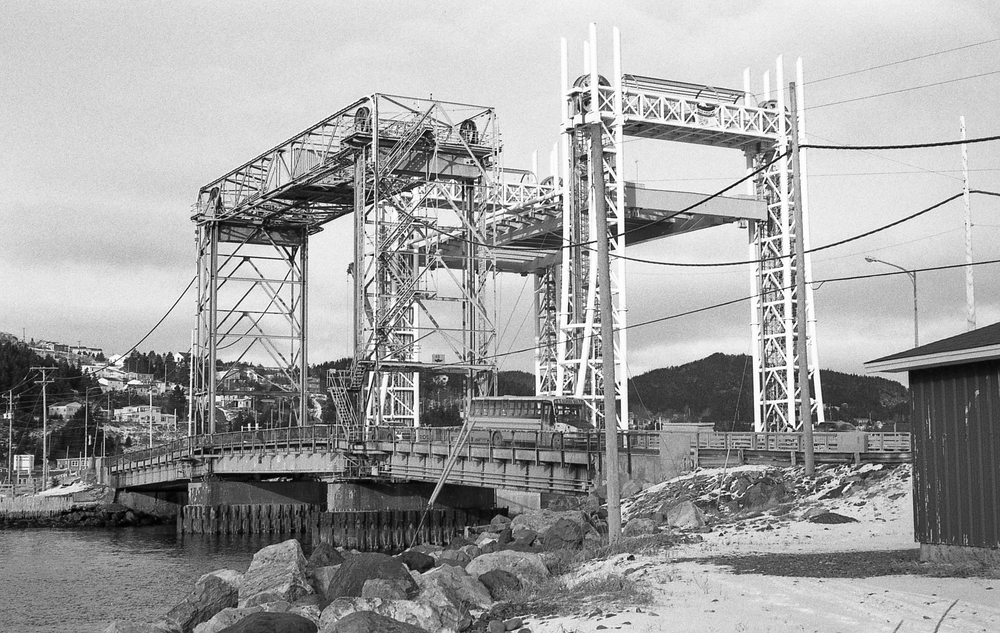 Entrance to Placentia Harbour. The original lift bridge, opened in 1961,  stands next to its almost ready modern replacement.