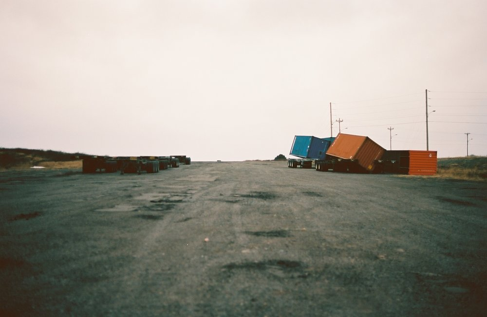 Shipping containers toppled by the wind