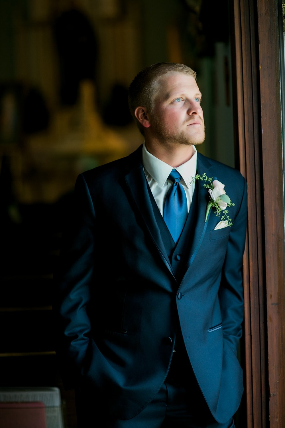 windthorst-st-mary-catholic-church-parish-hall-sharp-arrow-events-jameson-flowers-wichita-falls-wedding-photography-033.jpg