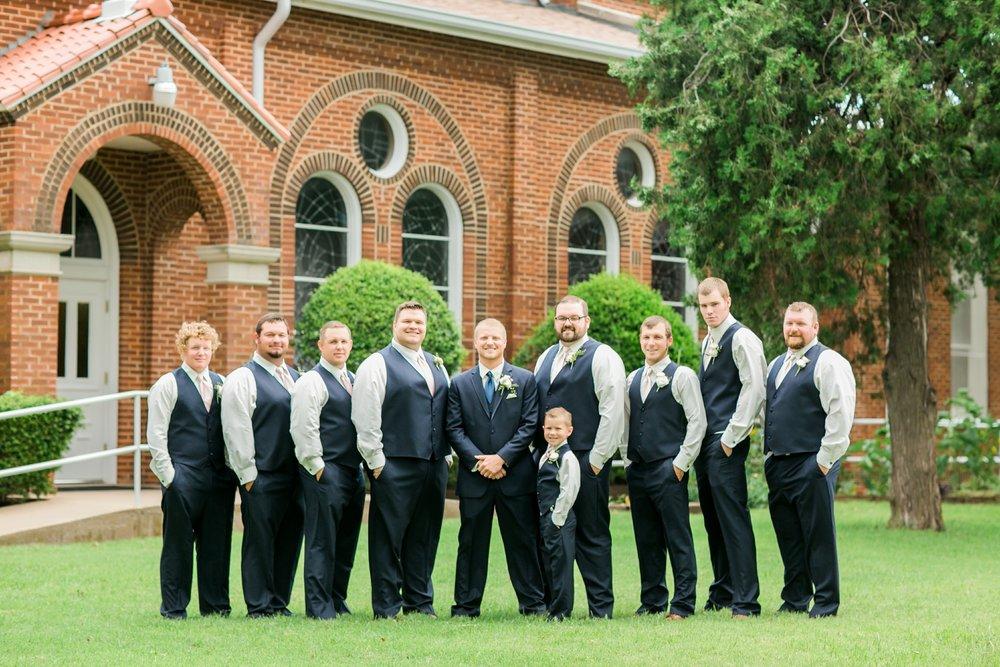windthorst-st-mary-catholic-church-parish-hall-sharp-arrow-events-jameson-flowers-wichita-falls-wedding-photography-034.jpg