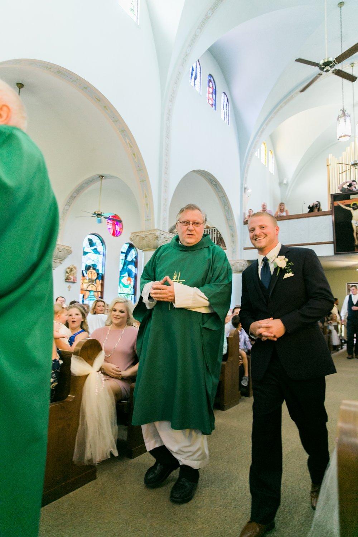 windthorst-st-mary-catholic-church-parish-hall-sharp-arrow-events-jameson-flowers-wichita-falls-wedding-photography-039.jpg