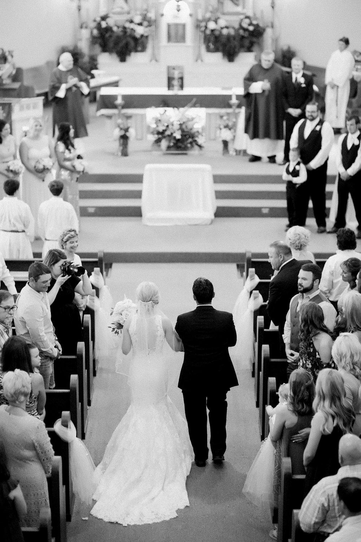 windthorst-st-mary-catholic-church-parish-hall-sharp-arrow-events-jameson-flowers-wichita-falls-wedding-photography-041.jpg