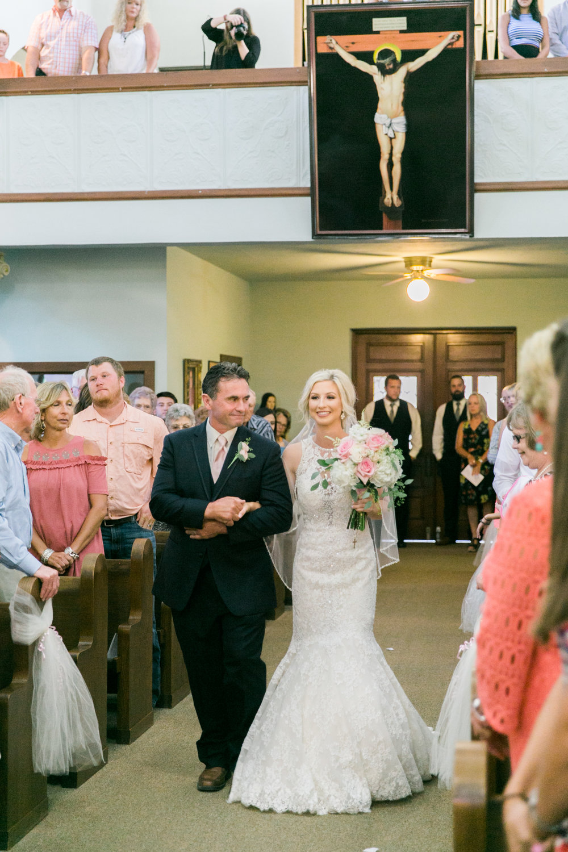 windthorst-st-mary-catholic-church-parish-hall-sharp-arrow-events-jameson-flowers-wichita-falls-wedding-photography-042.jpg