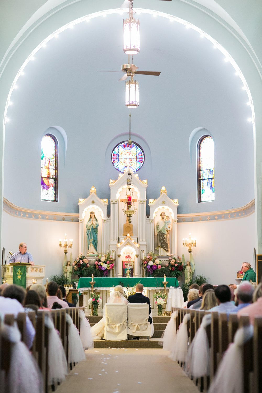 windthorst-st-mary-catholic-church-parish-hall-sharp-arrow-events-jameson-flowers-wichita-falls-wedding-photography-047.jpg