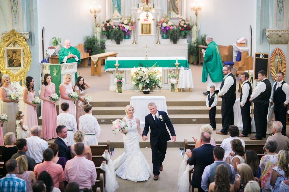 windthorst-st-mary-catholic-church-parish-hall-sharp-arrow-events-jameson-flowers-wichita-falls-wedding-photography-052.jpg