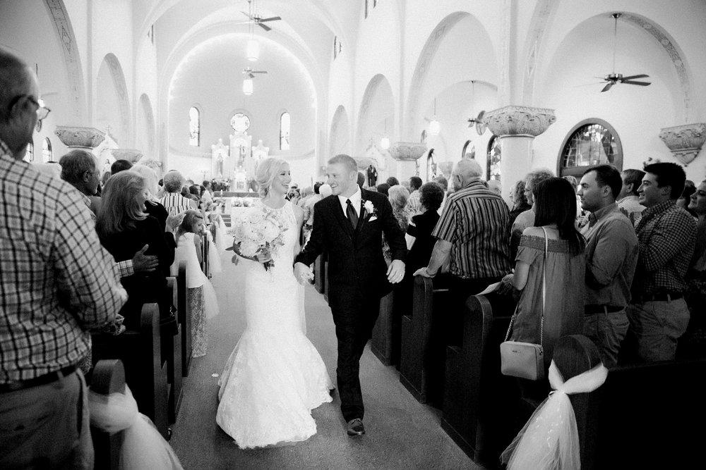 windthorst-st-mary-catholic-church-parish-hall-sharp-arrow-events-jameson-flowers-wichita-falls-wedding-photography-053.jpg
