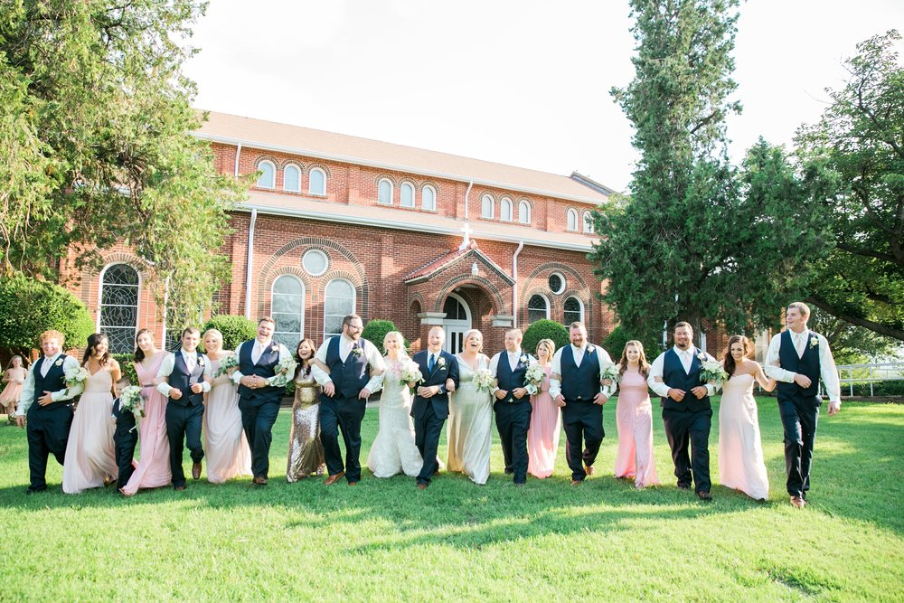 windthorst-st-mary-catholic-church-parish-hall-sharp-arrow-events-jameson-flowers-wichita-falls-wedding-photography-061.jpg