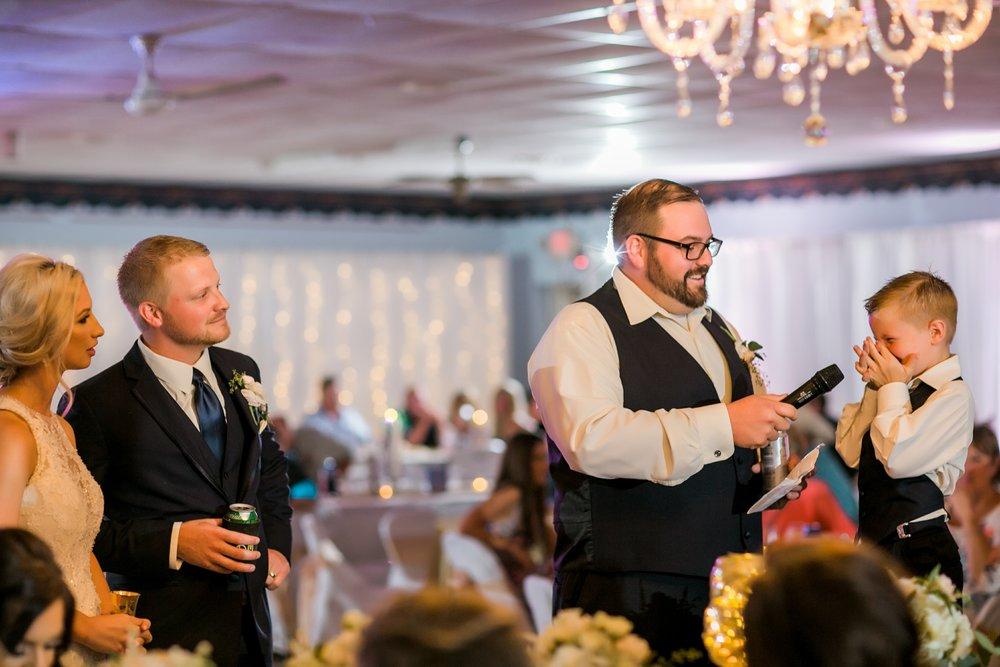 windthorst-st-mary-catholic-church-parish-hall-sharp-arrow-events-jameson-flowers-wichita-falls-wedding-photography-091.jpg