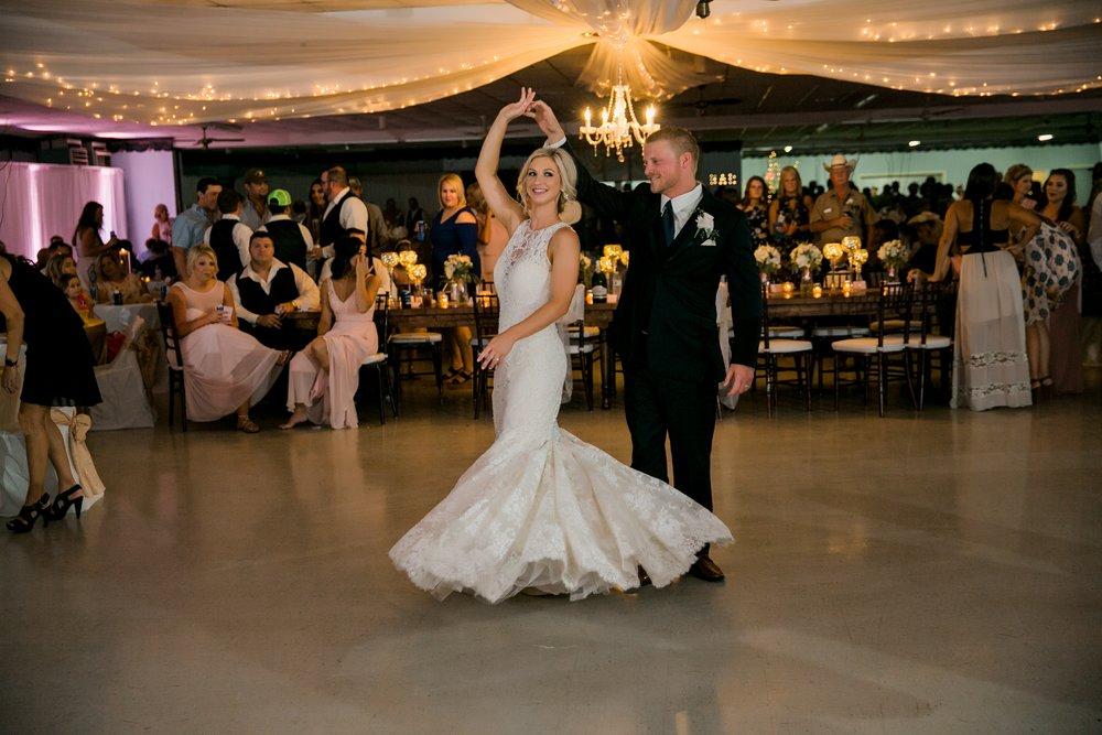 windthorst-st-mary-catholic-church-parish-hall-sharp-arrow-events-jameson-flowers-wichita-falls-wedding-photography-116.jpg