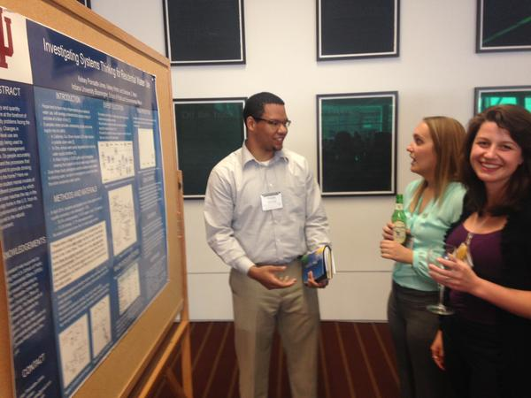 Kelsey Poinsatte-Jones and Kelsey Hinton presenting research at a conference