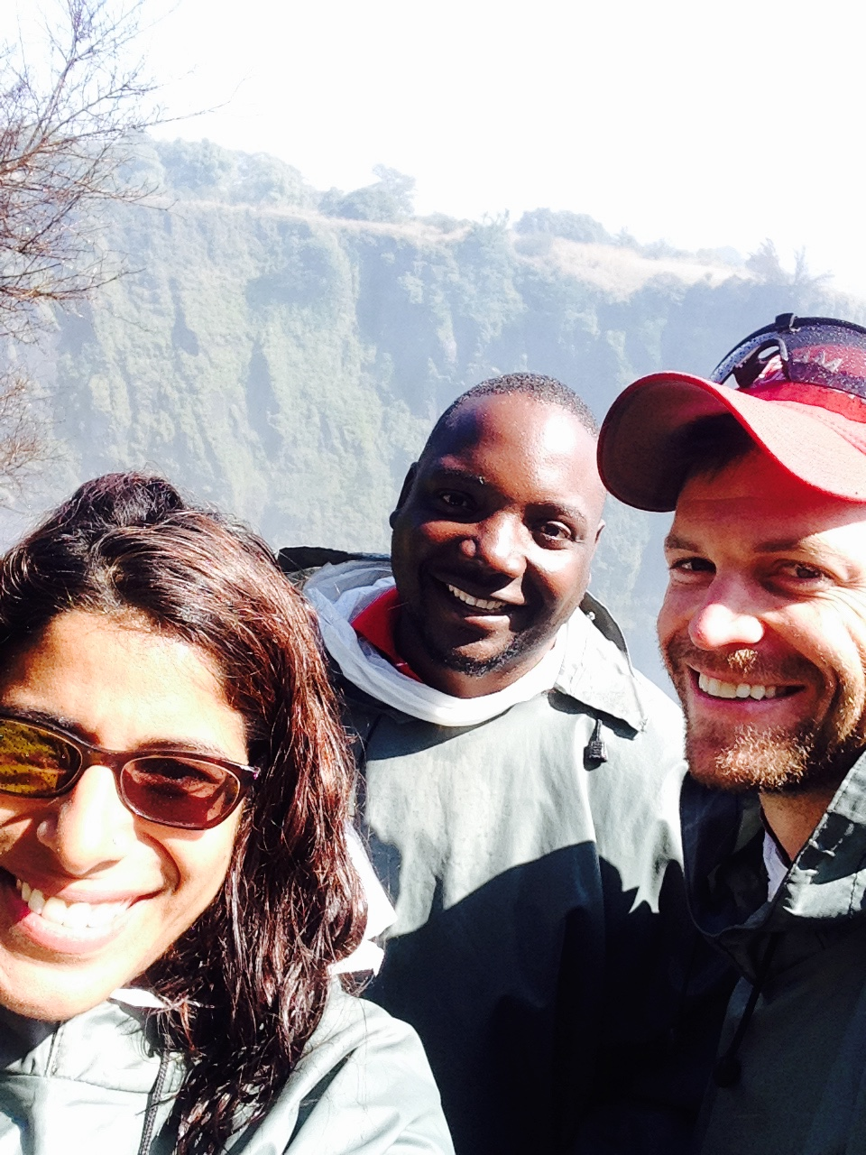 Shahzeen, Allan, and Drew - Happy and soaked at Victoria Falls, Zambia 2015