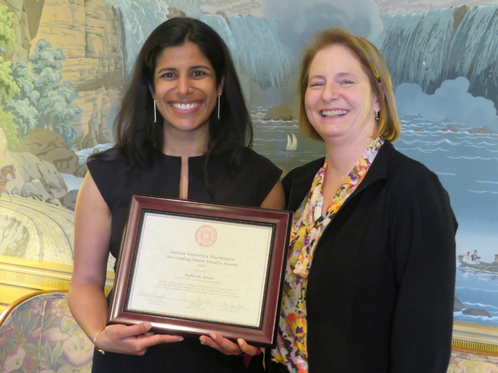 Shaz receives the award from Eliza Pavalko, IU's Vice Provost for Faculty and Academic Affairs