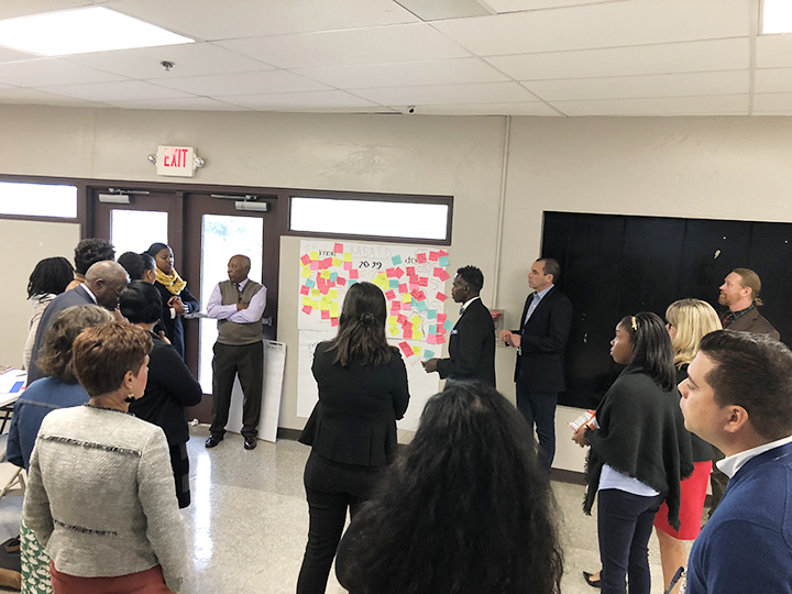 The Howard Connect Academy (HCA) design team members engage in discussion and brainstorming around design principles for the new school.