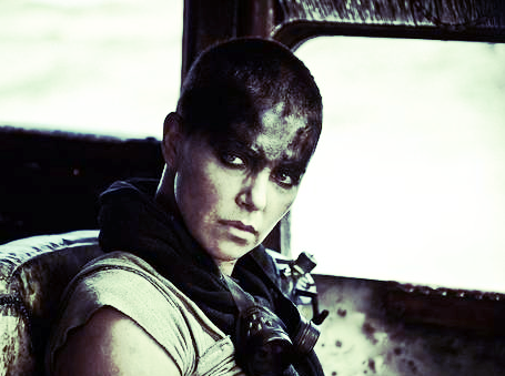 FURIOSA (Charlize Theron) is the heroine of MAD MAX: FURY ROAD. Because her mission is so important to her, she can easily differentiate between what's worth her time and what's not. photo: Max Max is the property of Warner Brothers.