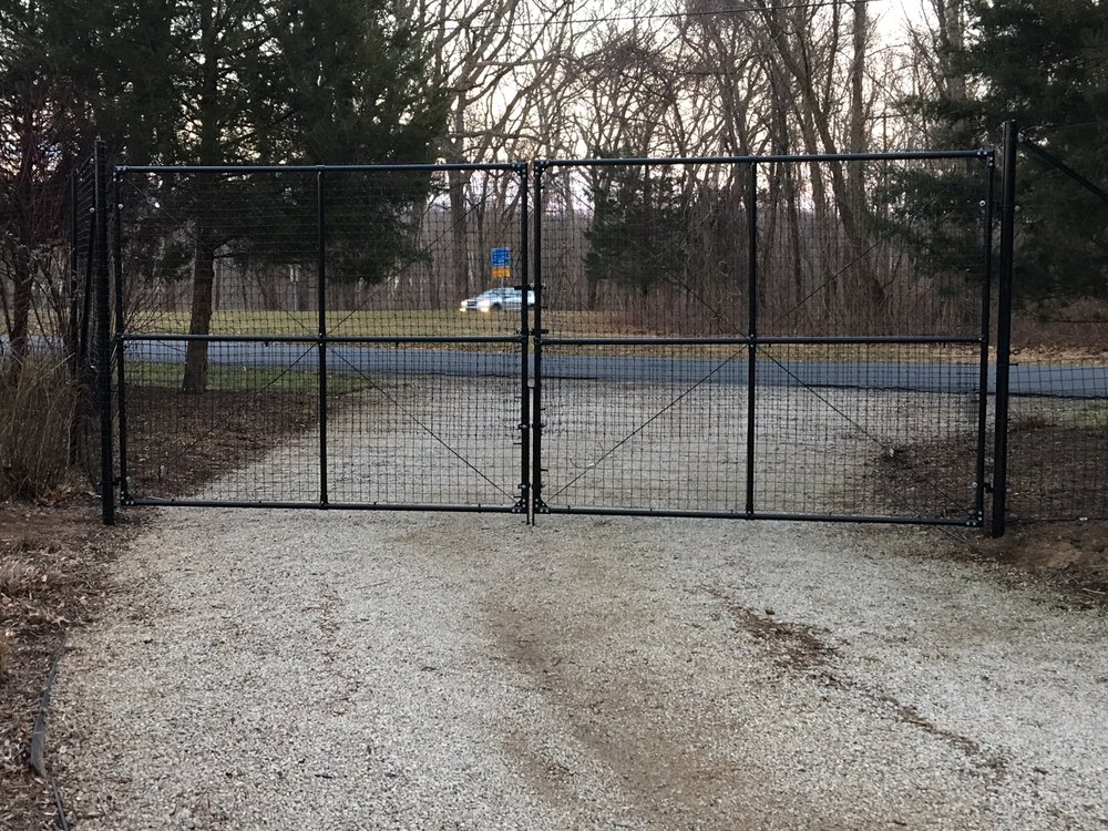 Double driveway gate system located 20 feet from road.