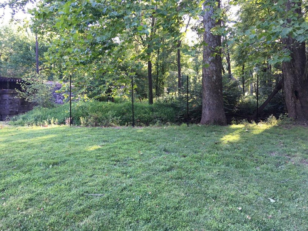 Perimeter deer fence viewed from 60 feet in Bucks County, PA.