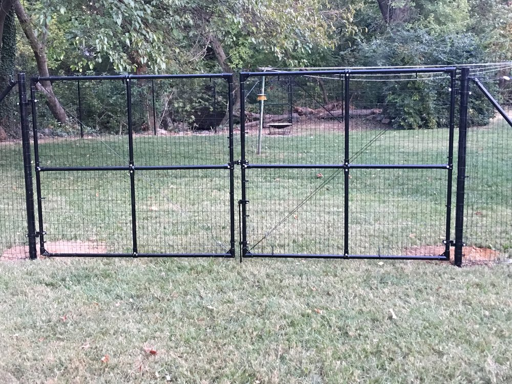 """12"""" wide double access gate system on 2 1/2"""" gate posts for deer and dog fencing."""
