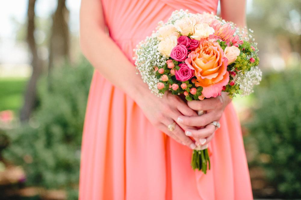 Free Spirit Roses, Hot Pink Dahlia, Lovely Lydia Spray Roses, Hot Pink Hypericum Berries, Bupleurum, and Baby's Breath.