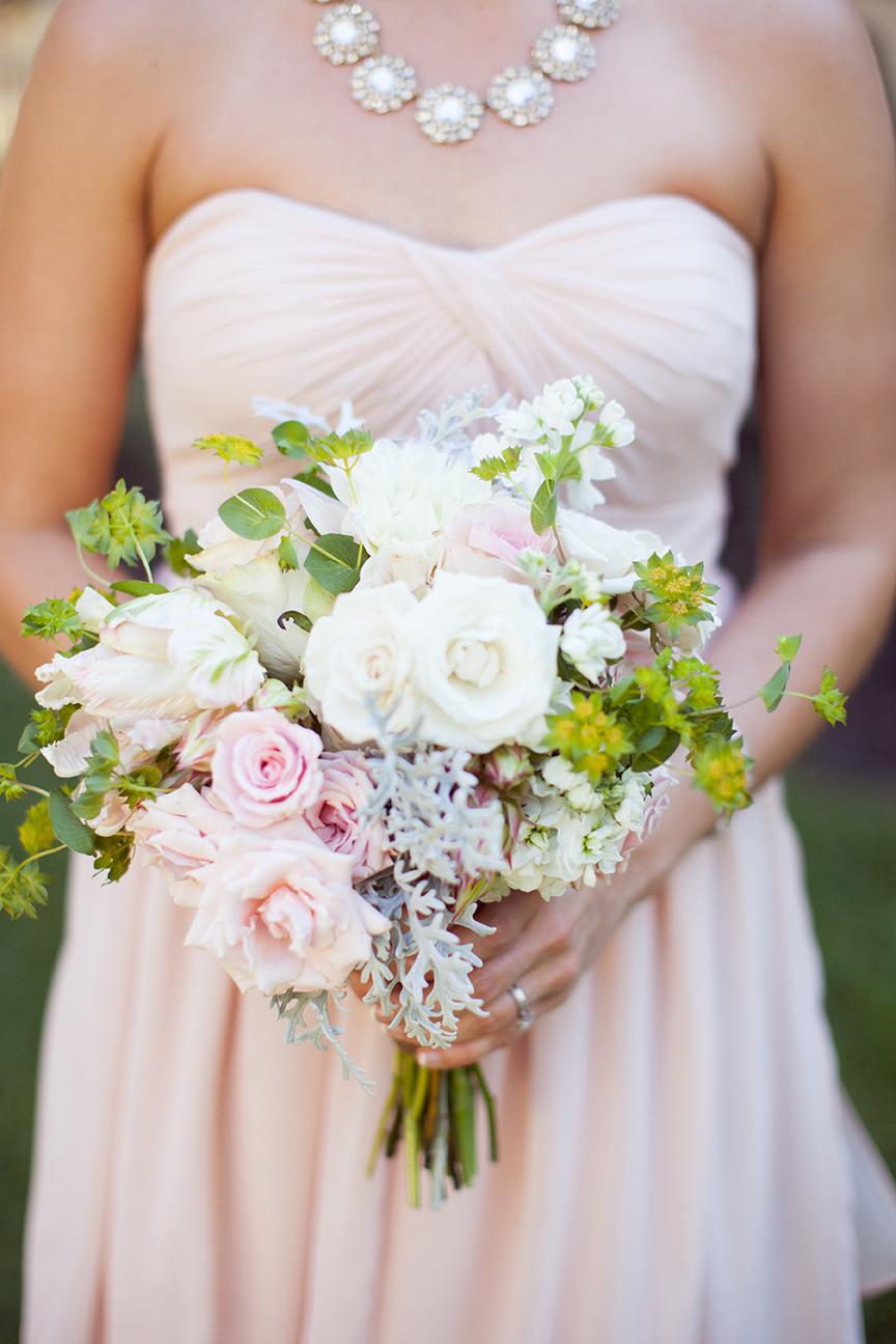 Bridal Akito Roses, White and Pink Mojalika Spray Roses, Pink Parrot Tulips, Green Hydrangea, Bridal Veil Protea, White Stock, Bupleurum and Dusty Miller.