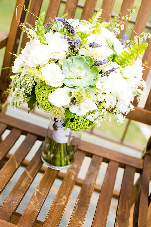White Peonies, White Ranunculus, White Calla Lilies, White Freesia, White Lisianthks, Lavender Springs, Green Viburnum, Queen Anne's Lace, Green Succulents and Green Viburnum.