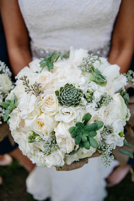 White Hydrangea, Vendela Roses, White Fringe Tulips, White Alabaster Garden Roses, Green Succulents and Naked Eucalyptus.