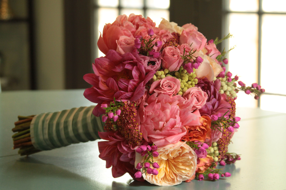 Coral Charm Peonies, Coral Dahlias, Juliet Garden Roses, Veronia Heather, Free Spirit Roses, Coral Cottage Yarrow, Lime Berzilla  Berries, and Ilse Spray Roses.