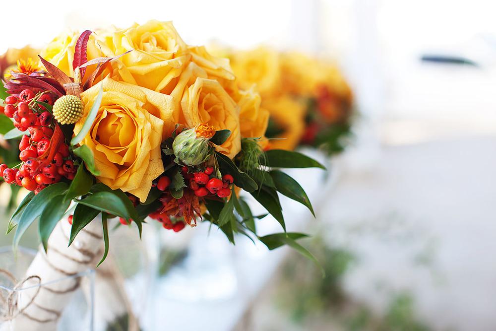 Creme Brulee Roses, Safflower, Craspedia, Pyracantha, and Italian Ruscus.