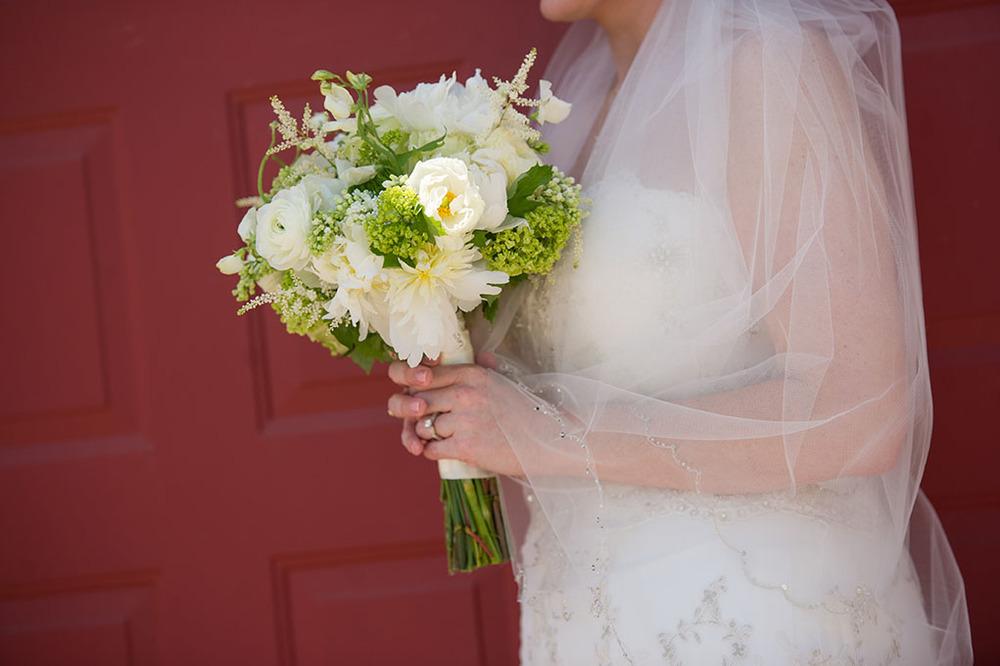 Snowball Viburnum, White Peonies, White Hydrangeas, White Lisianthus, White Astilbe, Mondial Roses, White Sweet Peas, White Lilac, and Green Dianthus.