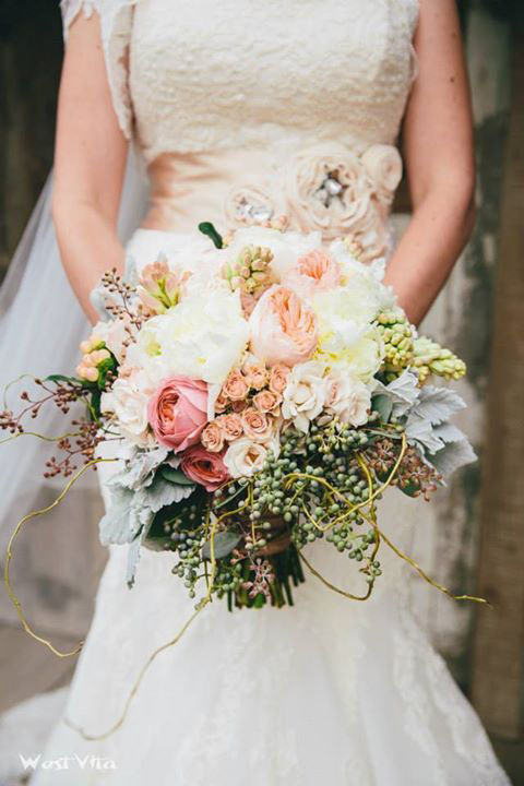Romantic Antique and Juliet Garden Roses, White Peonies, Tuberoses, Hydrangea, White Majolikas, Sweet Sara Sprays, Blush Hypericum, Texas Privet, Seeded Euc., Dusty Miller, and Curly Willow Tips.