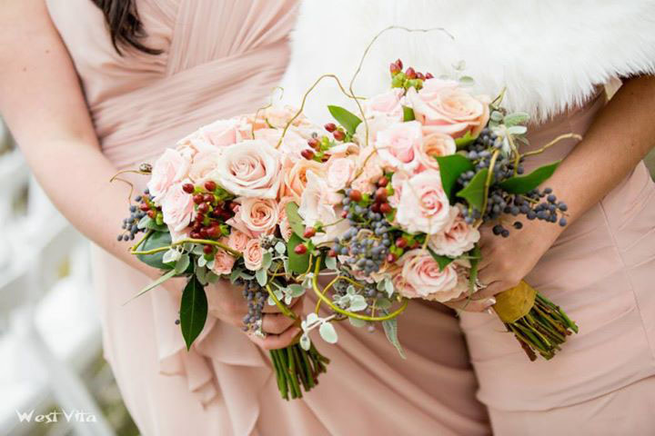 Mother of Pearl and Sahara Roses, Pink Majolika and Sweet Sara Spray Roses, Red Hypericum Berries, Privet, Lemon Tips, Wooly Butterfly, and Curly Willow Tips.